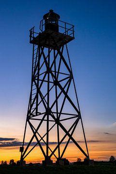 Sfeervolle zonsondergang op schokland  in oude haven met industrieel ijzeren voortoren van Fotografiecor .nl