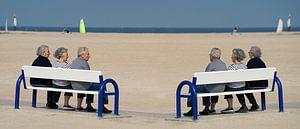 Genieten met drie tweelingen op het strand van