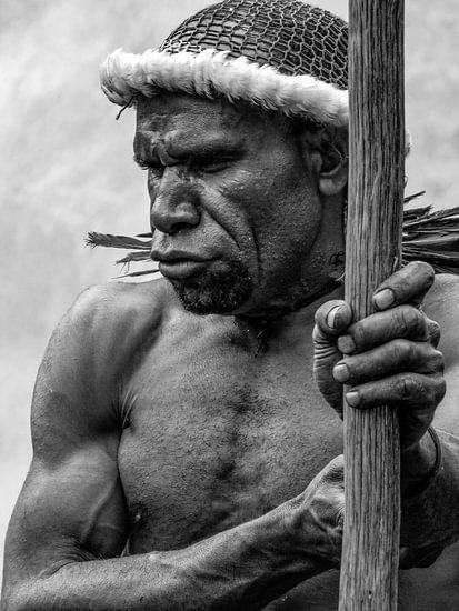 Man carries spear