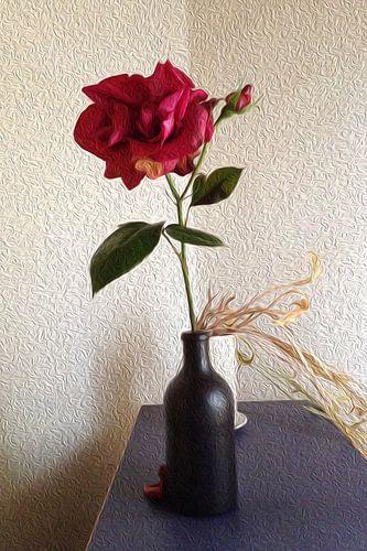 Rode roos in zwarte fles