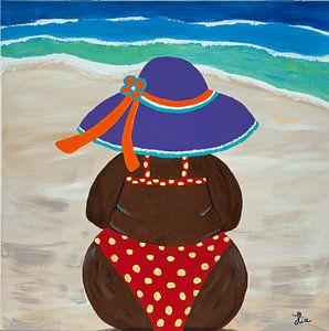 Dikke dame op het strand van