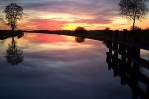 Prachtige zonsondergang over het kanaal van Frouwkje Fotografie
