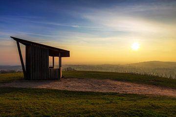 Hut in de zonsondergang
