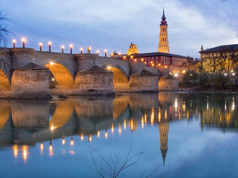 Medieval bridge and El Salvador cathedral (La Seo) reflecting on the Ebro river.