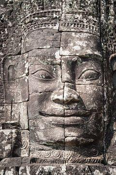 Glimlach van Boeddha in de Bayon tempel, Cambodja van