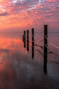 zonsopkomst aan de waddenzee van