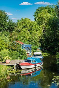 Boats on the river Warnow in Rostock van Rico Ködder
