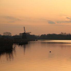 Zonsondergang bij de Rottemeren met molen silhouette van André Muller
