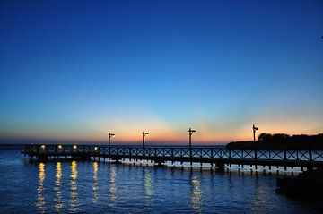 Steiger Pirate Bay, Curaçao, ondergaande zon van Martin Van der Pluym