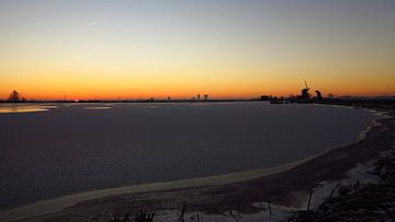 winterlandschap bij zonsopkomst van G. de Wit