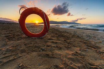 Rettungsring als Rahmen für die Sonne von Christian Klös
