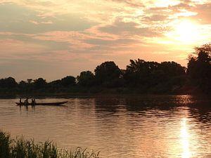 Rivier met zonsondergang  van