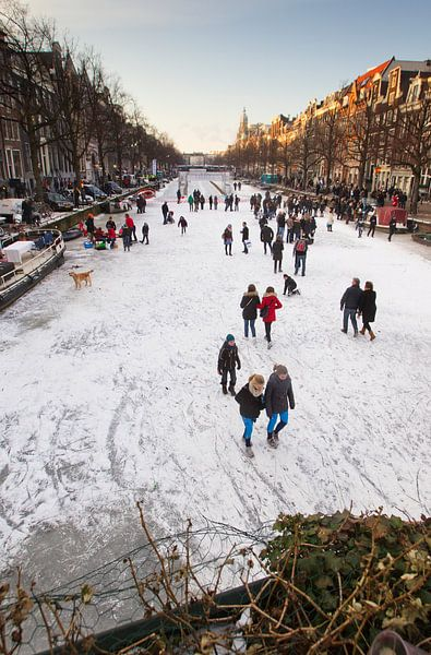 Schaatsen op de Amsterdamse grachten sur Paul Teixeira
