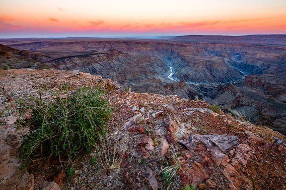 Zonsopkomst boven de Horseshoe Bend van de Fish River Canyon, Namibië