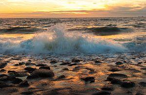 Uitzicht over de Noordzee bij zonsondergang