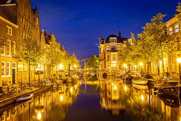 Leiden, Netherlands - July 22, 2020: Cityscape Leiden view Old Rhine with canal, houses and bridge d