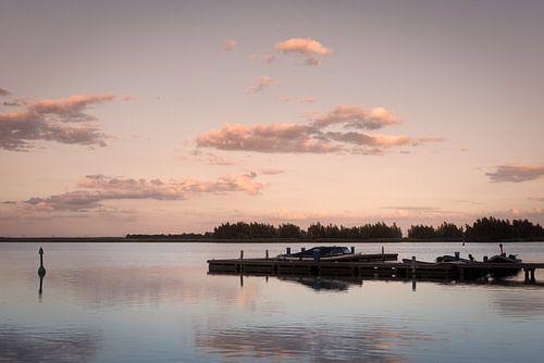 Boats at sunset van