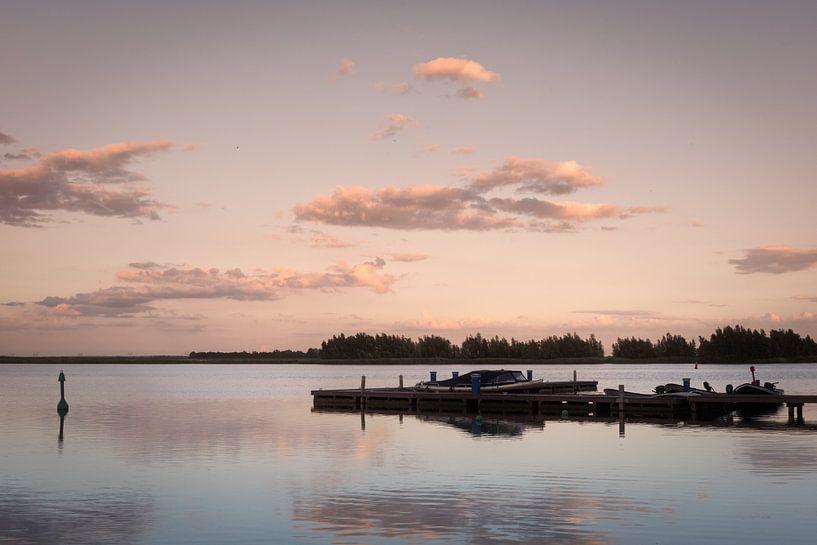 Boats at sunset van Trudy van der Werf