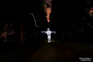 Lightpainting: Man on the Path van Jarno De Smedt