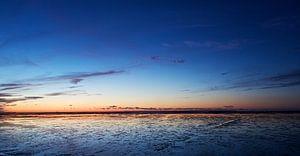 Het wad bij Paesens Moddergat na zonsondergang van