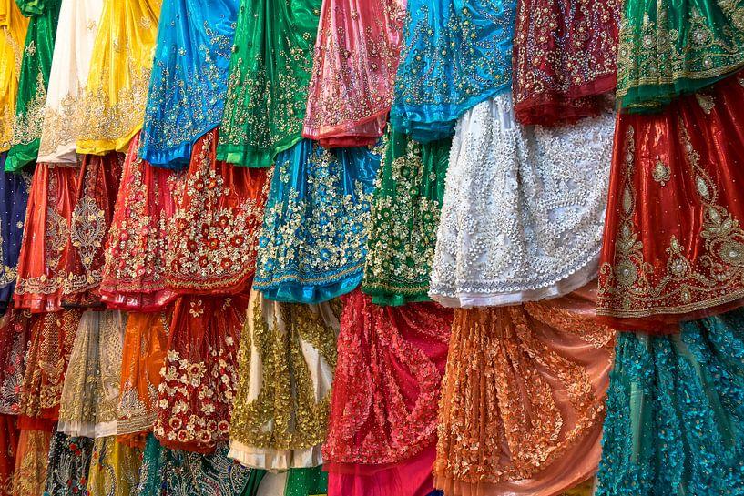 Colorful dresses  in a shop van Jeroen Kleiberg