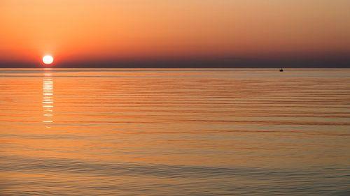 visser bij zonsopgang van