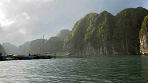 A fish farm in Lan Ha Bay, Vietnam, surrounded by karst mountains