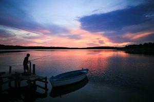 Vissen bij zonsondergang van