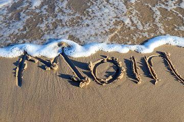 Salutation de l'Allemagne du Nord Moin écrite sur le sable de la plage de la mer Baltique