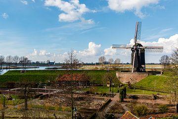 Windmolen aan de Bersche Maas in Heusden, Noord-Brabant, Nederland van WorldWidePhotoWeb