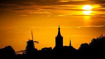 Zonsondergang boven Hasselt sur Karel Pops