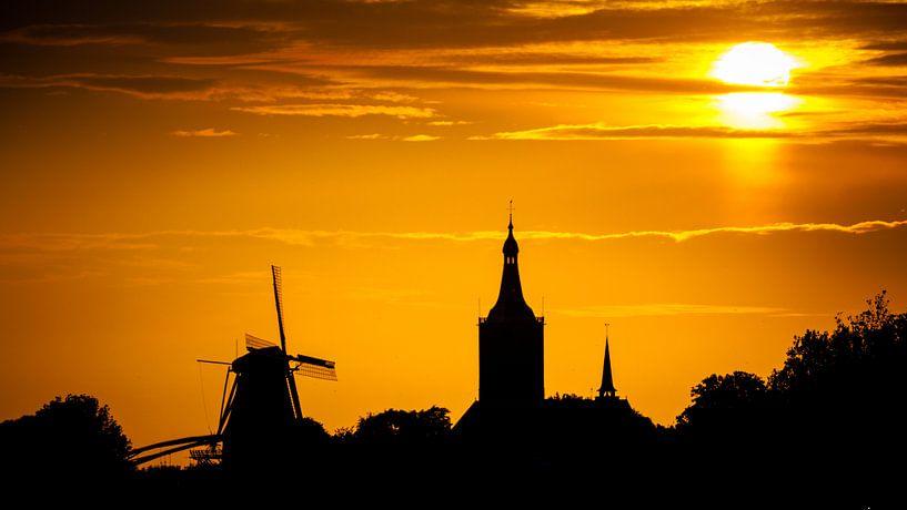 Zonsondergang boven Hasselt van Karel Pops