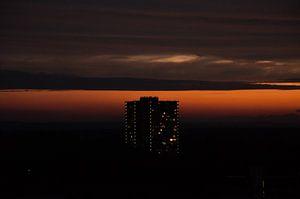 Zonsondergang bij een flat
