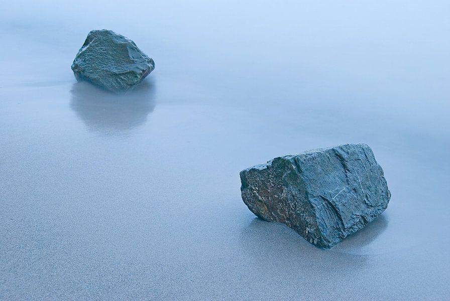 Zand, water, stenen
