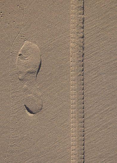 Stap in het zand