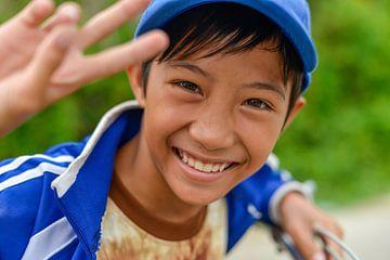 Vrolijke Vietnamese jongen van Richard van der Woude