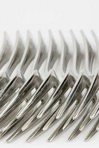 Abstracte verzameling van metalen vorken