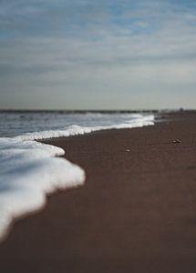 Wasserlinie am Strand.