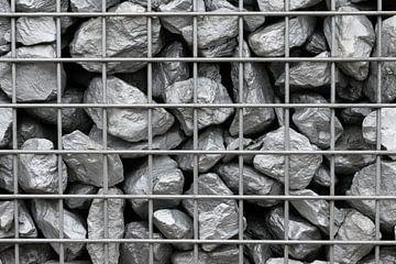 Pierres d'argent dans une grille de fer sur Patrick Verhoef