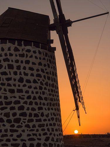 Windmill at sunset. van