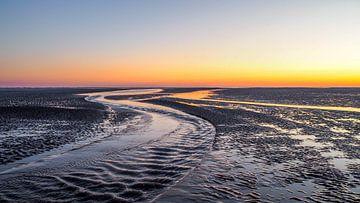 Zonsondergang op het Wad nabij Amland van