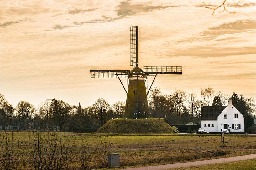 A Dutch Windmill with A yellow sky van Brian Morgan