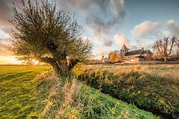 Zonsondergang bij de oude kerk in Oosterbeek van