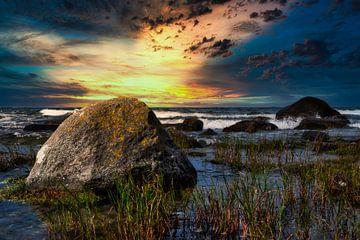 Des rochers dans le ressac au coucher du soleil