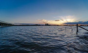 Sunset & Hoog water van Marjon Tigchelaar