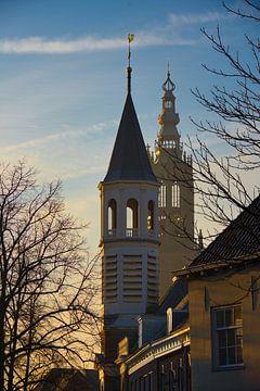 Le lever du soleil illumine l'église du Coude et la Tour de Notre-Dame sur Jerome van den Berg