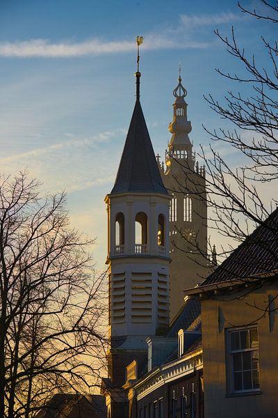 Zonsopkomst verlicht de Elleboogkerk en de Onze Lieve Vrouwe toren van Jerome van den Berg