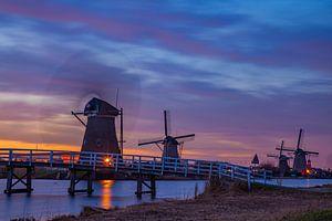 Zonsondergang bij molens in Kinderdijk. van Hartsema fotografie