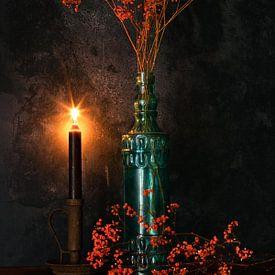 Orange gypsophila in blue bottle and Candle light. van Justin Sinner Pictures ( Fotograaf op Texel)
