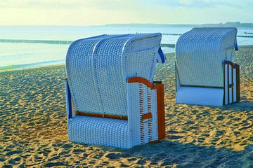 Two wicker beach chairs on the Baltic Sea beach van